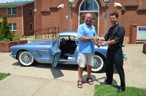 2013 Corvette winner Steve Lane of Chesaning, MI receives the keys from Father Chris Forler at St. Bernard Church on July 19th.